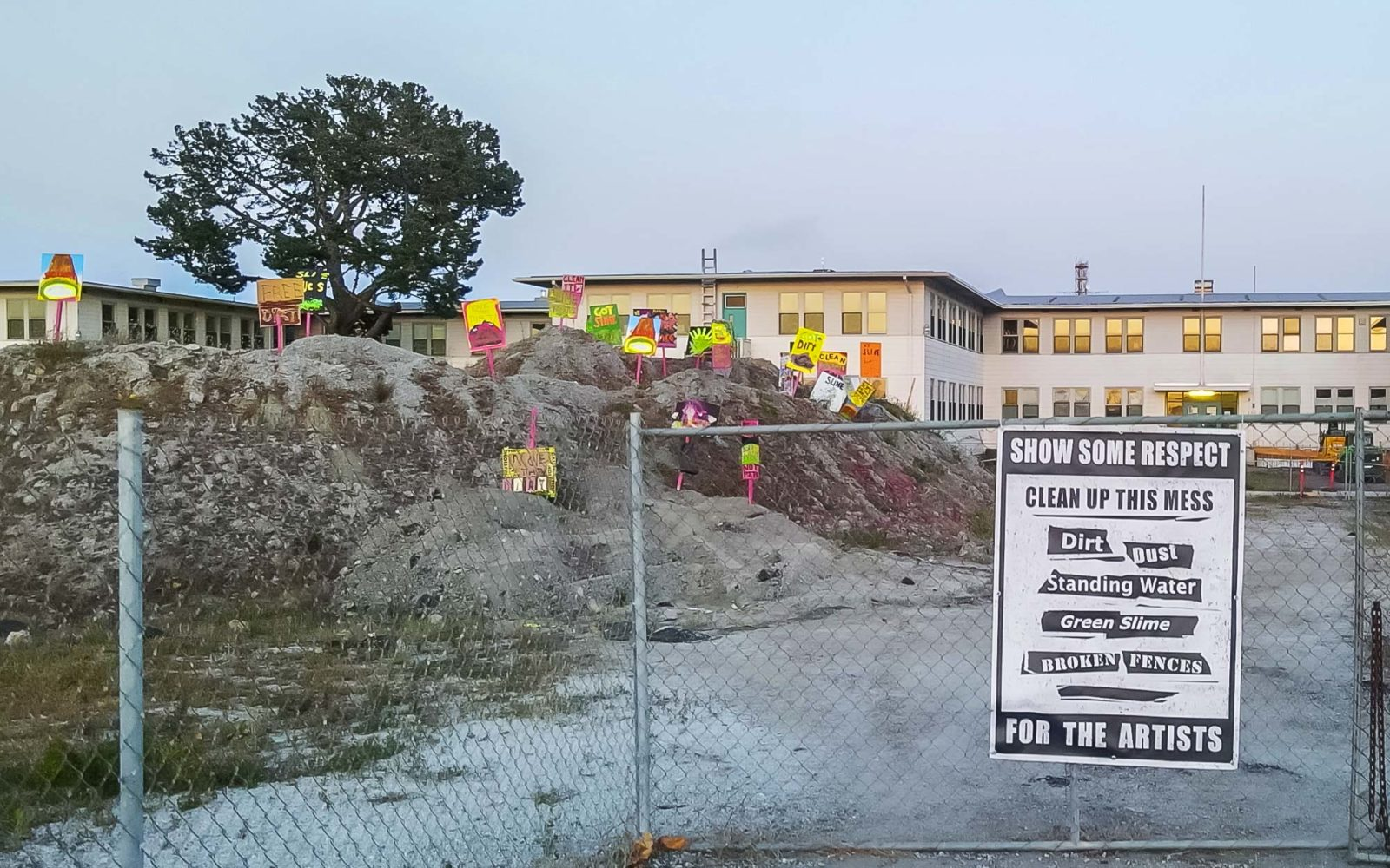 Protest signs on dirt pile